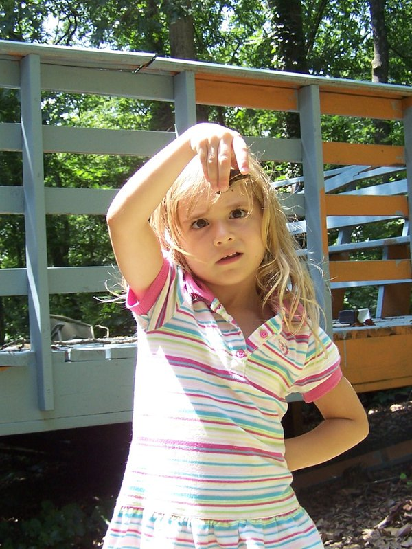 Spring day in the backyard with my three year old looking inquisitively at a small turtle. thumbnail