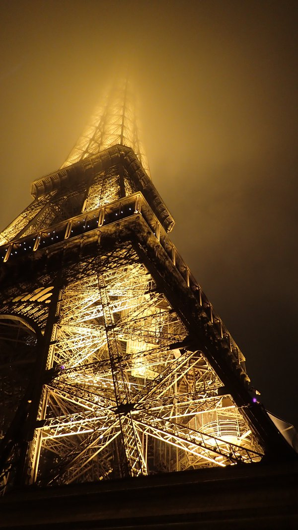 Eiffel Tower disappearing into fog thumbnail
