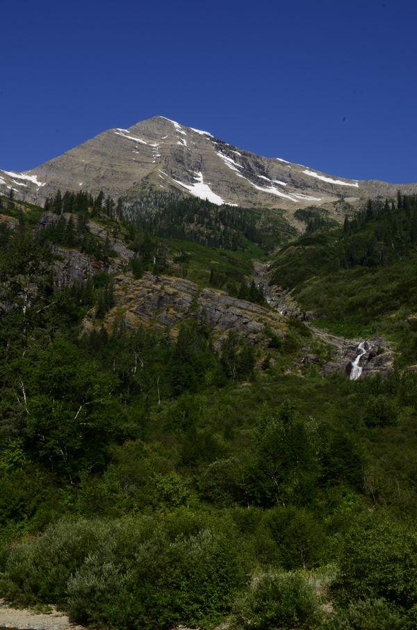 waterfall below Mountain peak thumbnail
