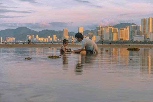 Father and daughter on the beach thumbnail