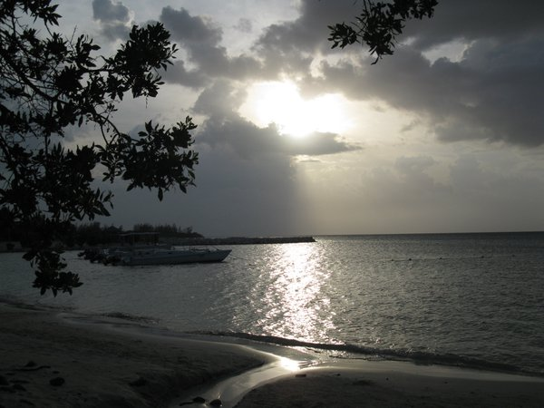 Sun peaking through clouds Montego Bay Jamaica thumbnail
