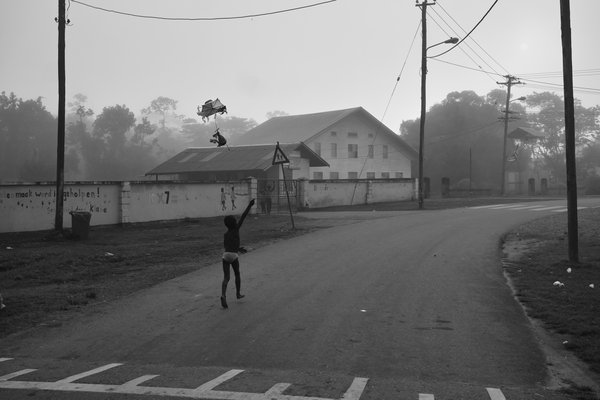 A boy flying a kite in a foggy morning in a Jungle village  thumbnail