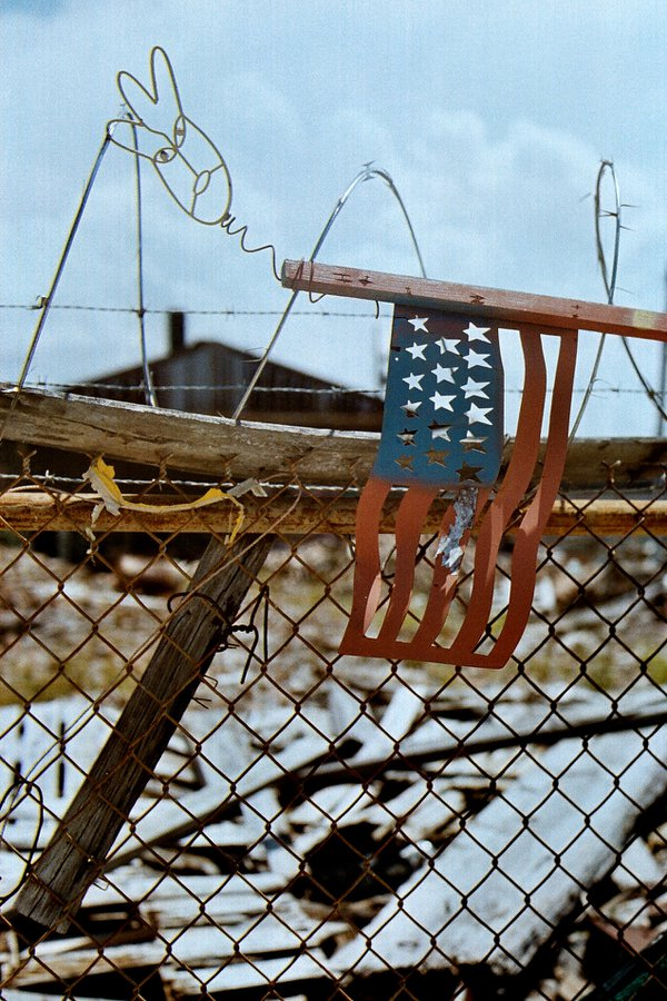 Abandoned destruction from near levy in New Orleans after Katrina.   35mm, Cannon AE-1, film thumbnail