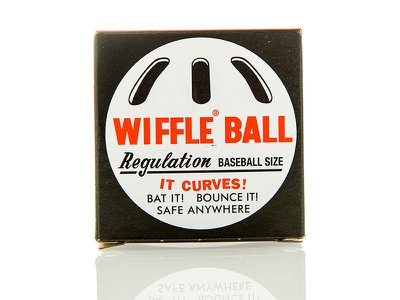 The Wiffle Ball comes with slots on one side to make it easier to throw curves and other pitches.