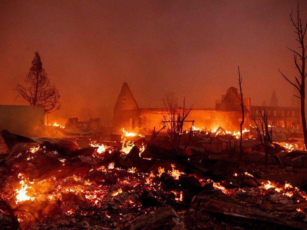 Buildings burn as the Dixie fire tears through downtown Greenville, California on August 4, 2021.