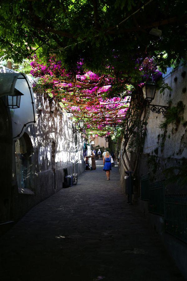 Woman walking through Positano thumbnail