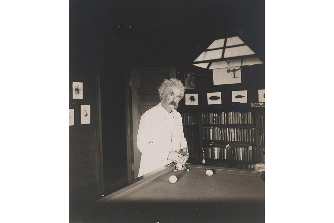 Mark Twain's best-known works of literature are laced with the fallacies and foibles of loveable con men. Undated photograph of Samuel Clemens by Albert Bigelow Paine, NPG, SI