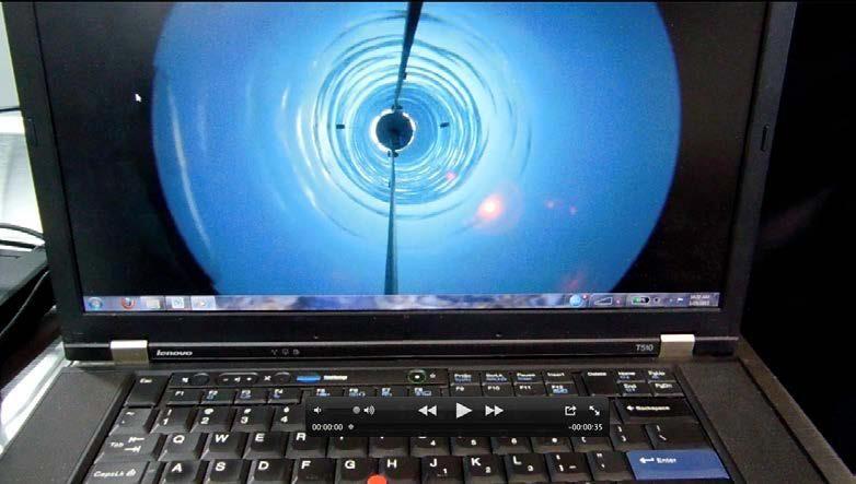 A camera passes down through the borehole.