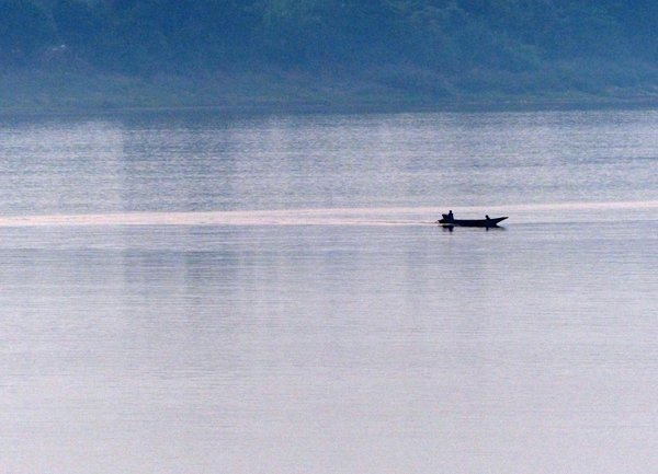 Lonely boatman on Mekong River thumbnail