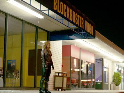 Brie Larson as Captain Marvel in front of a very-'90s strip mall