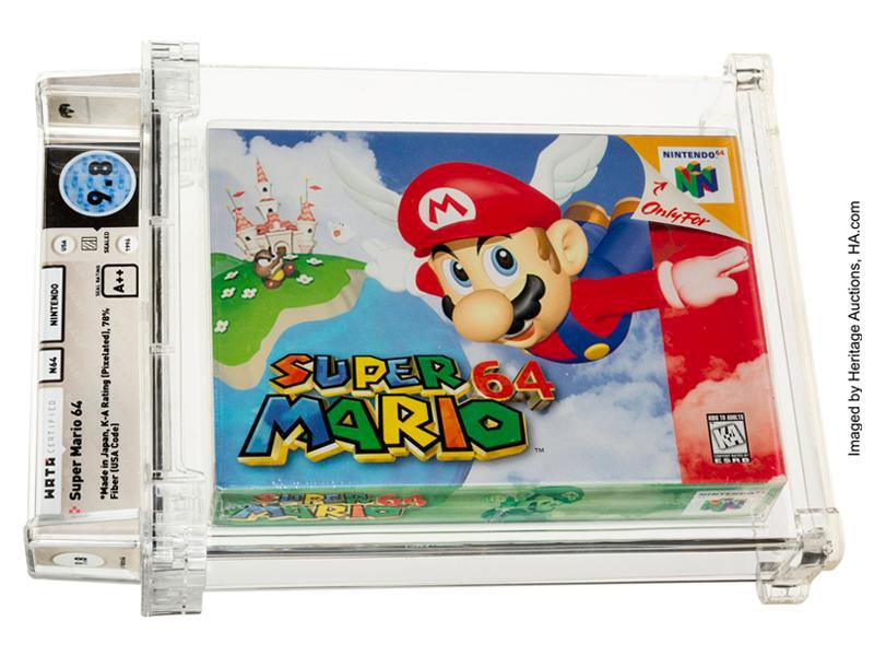 A video game cartridge in original packaging, with SUPER MARIO and Mario falling down from the sky on its front, encased in protective plastic and labeled with its rating