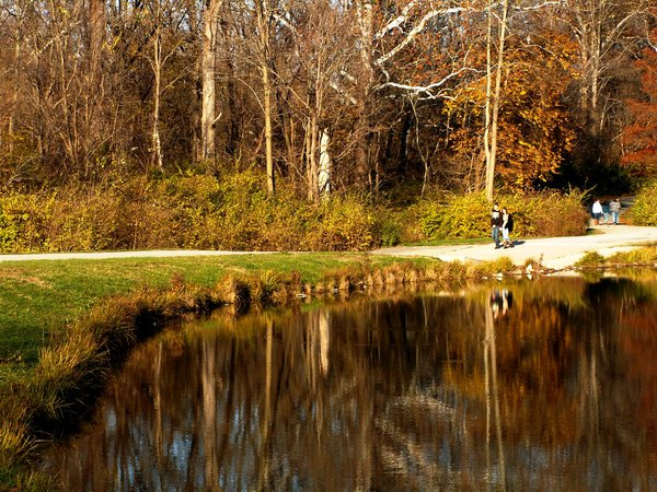 Couples and families take advantage of the path near the Duck Pond at Fort Benjamin Harrison State Park. thumbnail