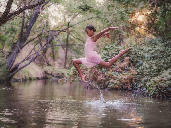 Kate leaps in the air during a dancer at the creek shoot. thumbnail