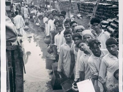 Refugees wait for water at a camp in Delhi. The partition of India put millions on the move.