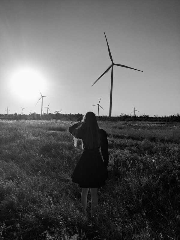 Girl running along the windmills thumbnail
