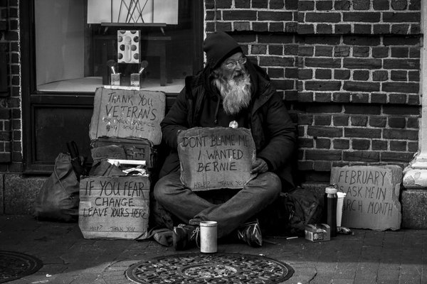 Homeless man with Don't Blame Me sign thumbnail