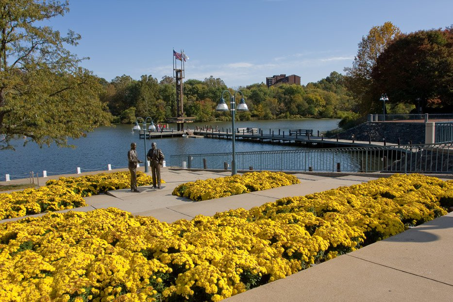 Columbia, today. Statues of Willard Rouse and James W. Rouse stand on the shore of Lake Kittamaqundi.