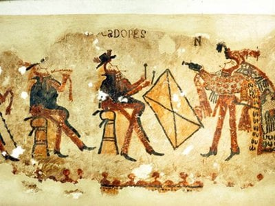 This wall painting features musicians in European clothing on the left and a dancer in a traditional feathered cape on the right.
