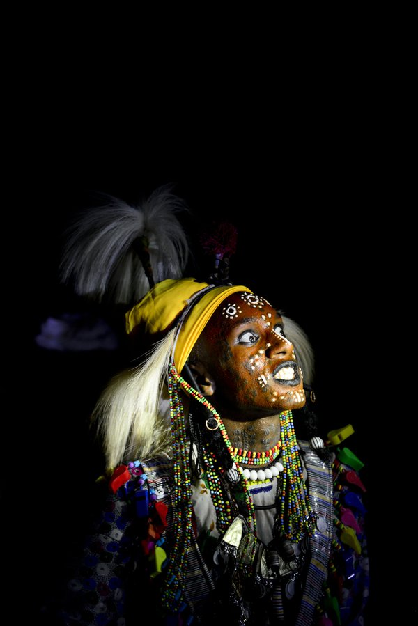 A bororo dances and sings in the dark in his traditional gerewol thumbnail