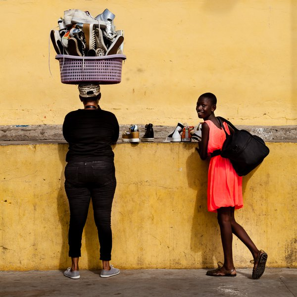 Shoe salewomen on the fishing dock in Takoradi, Ghana thumbnail