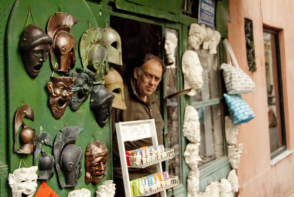 Athens store front and its owner thumbnail