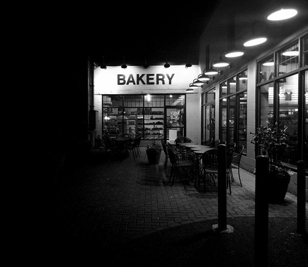 A bakery shop lit up at night thumbnail
