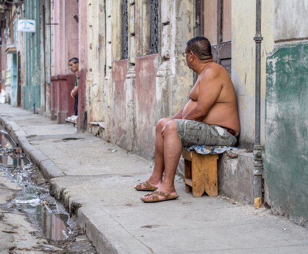 Men sitting outside doorways Havana Cuba thumbnail
