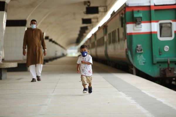 A father and son at the railway station platform in coronavirus pandemic thumbnail