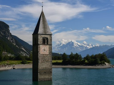 This July 9, 2020, photograph shows a 14th-century bell tower peeking out of Lake Resia in northern Italy. The building—and the historic town it once stood in—were submerged in an artificial lake in 1950 to generate power for a nearby hydroelectric plant.