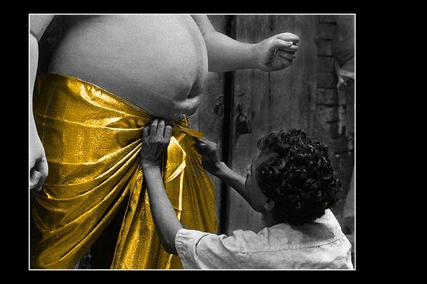 A clay modeller encloths his idol to get finish. Nikon FM camera, 50mm. lens. thumbnail