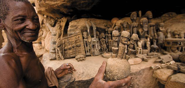 Dogon region villager with ritual figures