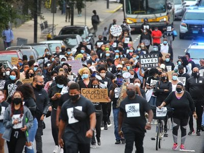 In Boston's Mattapan on August 15, 2020, protesters march from Jubilee Christian Church to protest police brutality, systemic racism and other oppressive systems unfavorable to Black and Brown people.