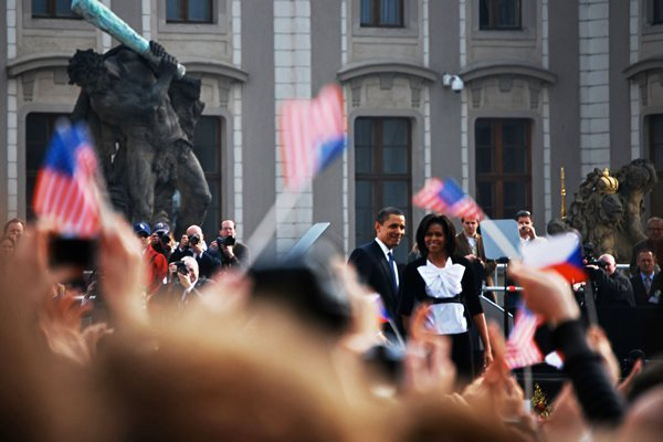 President and First Lady Obama greet the crowd after a public address in Prague. thumbnail
