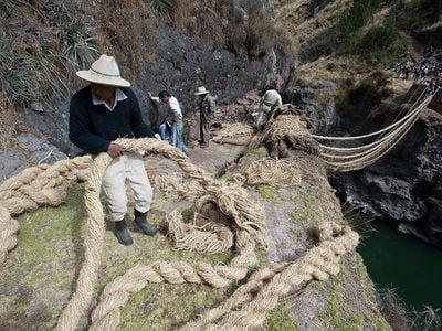 Villagers construct a new bridge over the Apurimac River, in Huinchiri, Peru, in 2012.