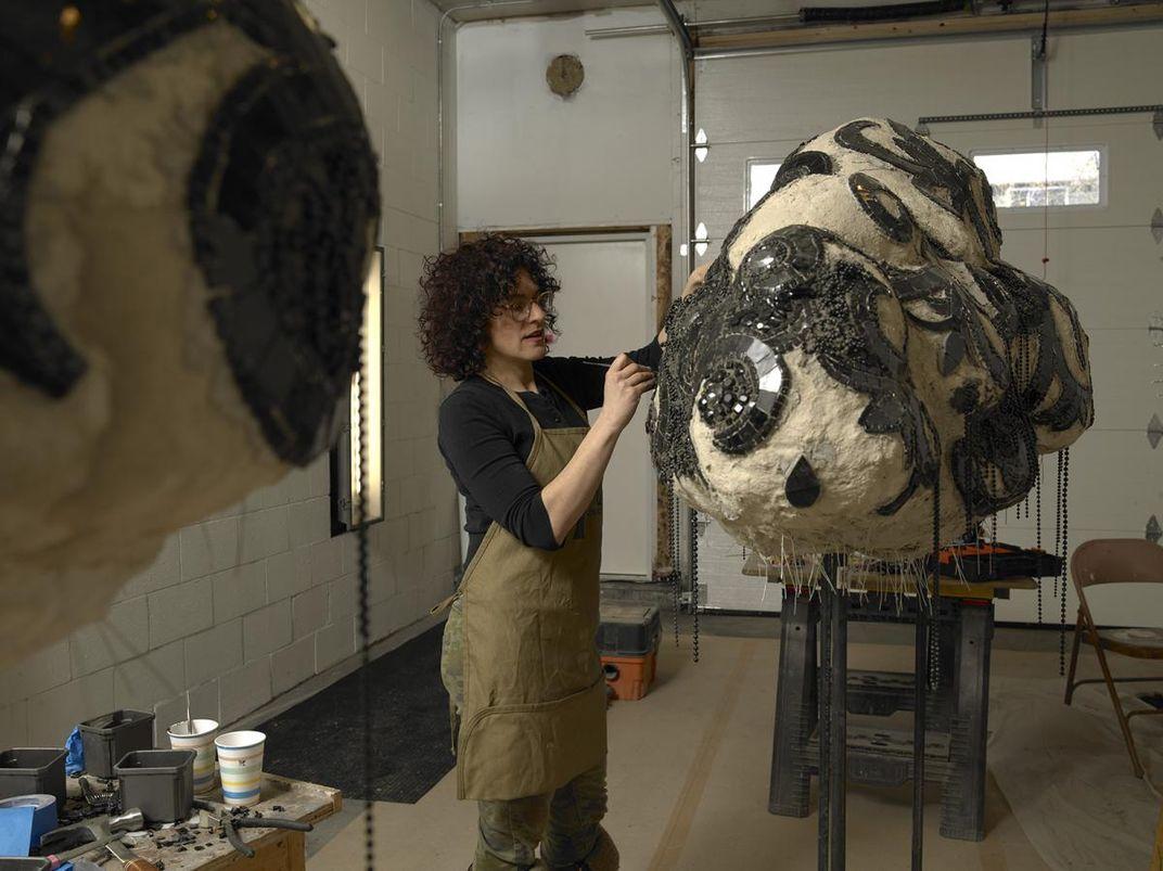 An artist working in her studio