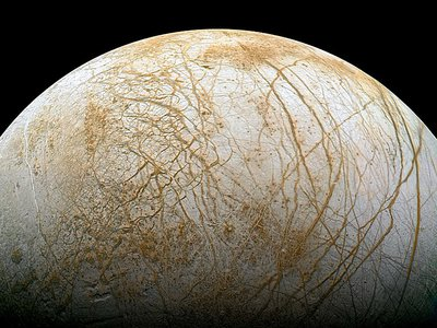 Jupiter's moon Europa, potentially home to a liquid water ocean, is considered one of the likeliest locales for extraterrestrial life.
