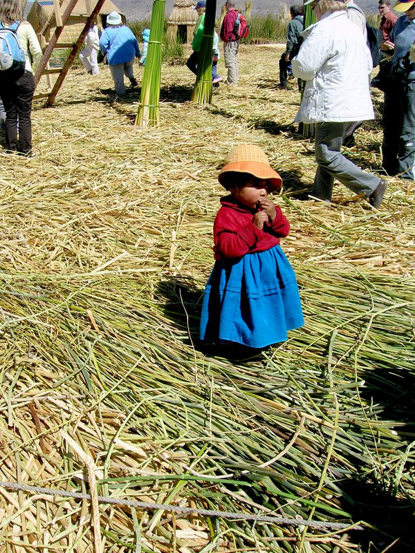 An isolated child on Uros Floating Island, Peru. thumbnail