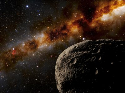 An artist's illustration imagines the newly discovered Farfarout (lower right), now confirmed to be the most distant object ever observed in our solar system. Farfarout is 132 times the distance of Earth to the sun (upper left) and is estimated to be around 250 miles across.
