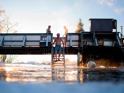 With air temperature at -17 degrees Celsius and water at 1 degree Celsius, Finns take a dip in an unfrozen hole of water after a sauna session in Vaasa, Finland.
