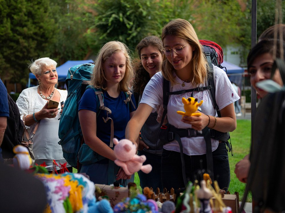 Visitors pick out crochet toys to purchase at the My Handmade Armenia Festival.