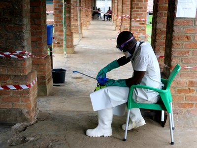 A health care worker wears virus protective gear at a treatment center in Bikoro, Democratic Republic of Congo, the epicenter of the latest outbreak.