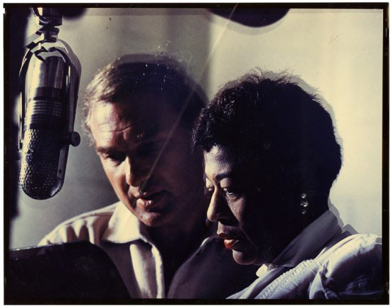 Norman Granz and Ella Fitzgerald at a microphone, 1950. (Ella Fitzerald Papers, NMAH Archives Center)