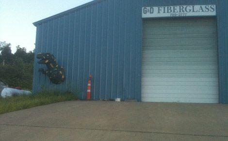 A Tyrannosaurus busting out of a fiberglass shop near Hindsville, Arkansas