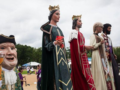 """The giants and big heads have been a hit among Folklife Festival-goers, says performer Jesus Bach Marques. """"They're amazed by our giants! For most of them, it's something really new."""""""