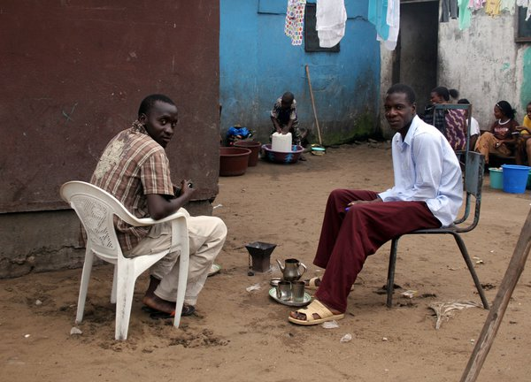 Young African men drinking tea and chatting. thumbnail