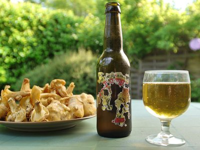 The author enjoys a previously-stashed beer and a plate of chanterelles in in the Périgord region of France.