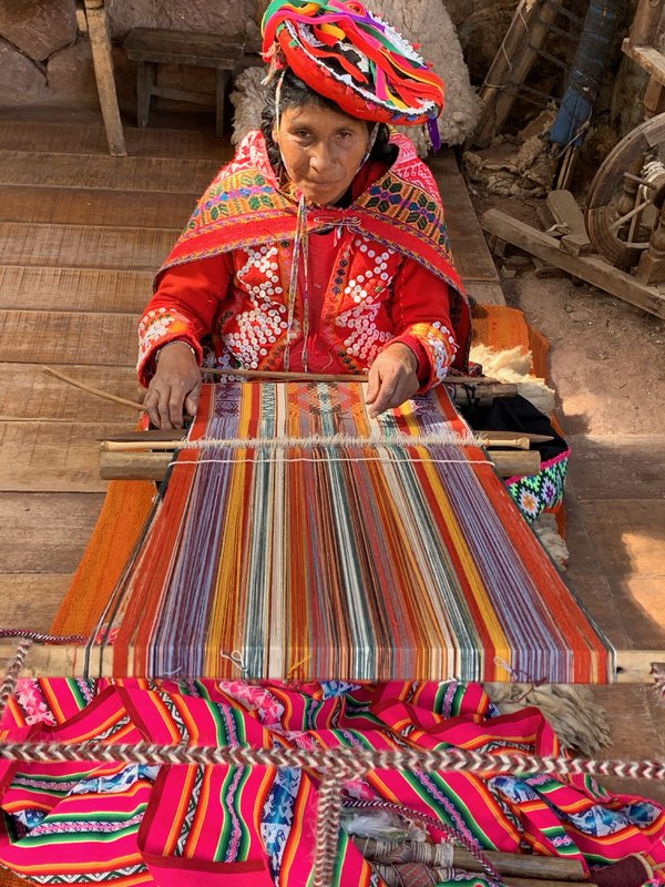 Mayan woman weaving an alpaca blanket in Peru thumbnail