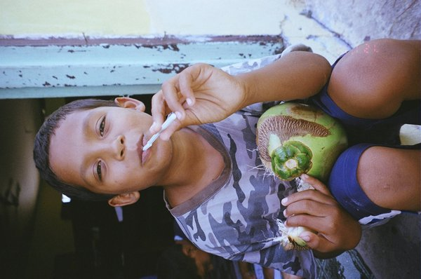 Ernesto enjoying a fresh coconut in Belize thumbnail