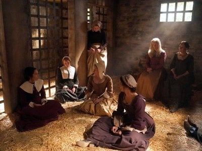 Lucy gets tossed in with the other accused witches in Salem.