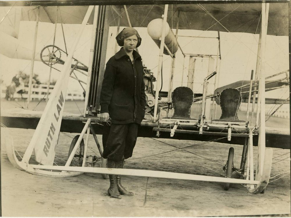Ruth Law stands in front of her Wright Model B biplane at the New York State Fair, Yonkers, 1913.